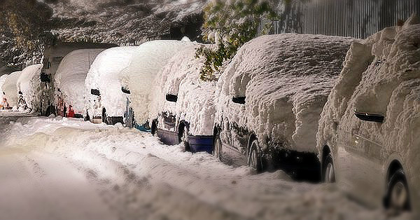cold weather cars covered in snow on street in winter